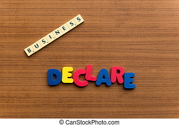 declare colorful word on the wooden background