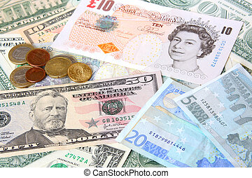Money. World currencies: U.S. dollars, pounds and euros....