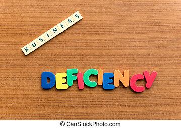 deficiency colorful word on the wooden background