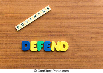 defend colorful word on the wooden background