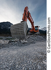 perspective of huge shovel with excavator digging in stone...