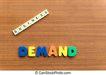 demand colorful word on the wooden background