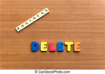 delete colorful word on the wooden background
