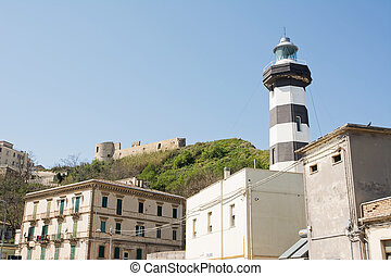 Lighthouse of Ortona overlooked by Castello Aragonese