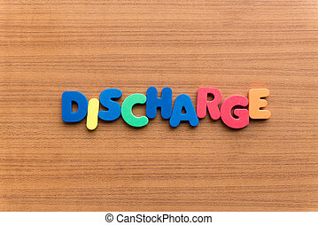 discharge colorful word on the wooden background