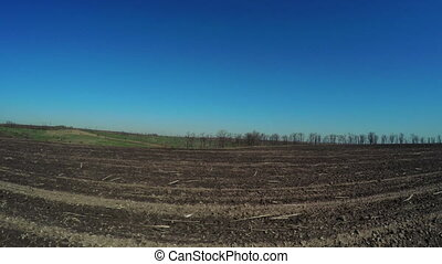 Bare soil - Camera on steadicam over plowed field