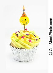 yellow cupcake and smiley candle