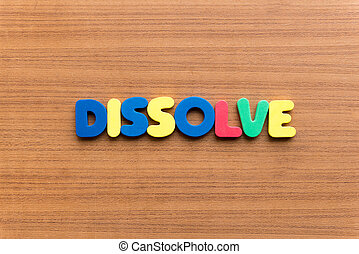 dissolve colorful word on the wooden background