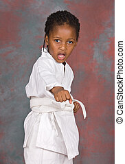 karate - Small karate girl training , on colorful background...