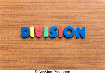 division colorful word on the wooden background