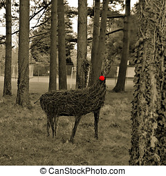 raindeer enhanced - Raindeer made from wicker in a copse of...