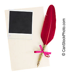 feather pen with old page and instant photo isolated on...