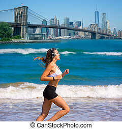 Brunette girl running in New York Brooklyn bridge photo...