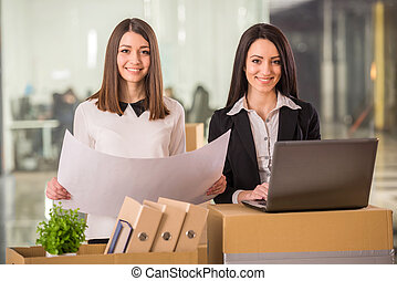 Business move - Two adult businesswomen planning out their...