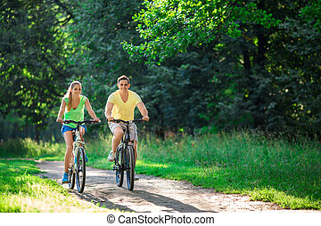 Active people - Young couple on bicycles in the park