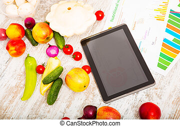 Healthy nutrition and tablet - Organic fruit and vegetable...
