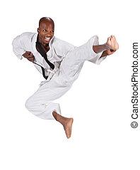karate - african american man in karate suit, suspended in...