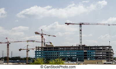 Construction site with cranes .