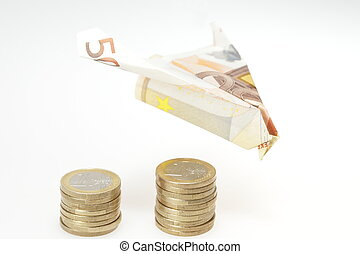 plane and money - money concept with pile of coins and money...