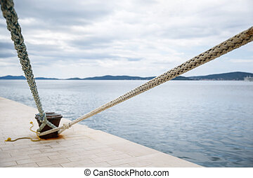 Weathered ropes attached to the pier - Heavy duty and...