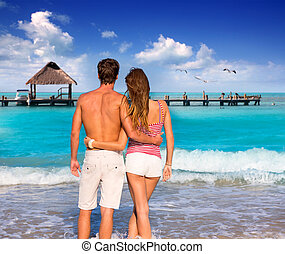 Couple of young tourists in a tropical beach - Couple of...