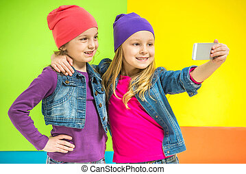 Kids - Best friends Two cute little girls doing selfie on...