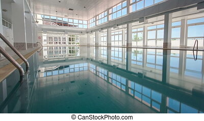 view of an indoor swimming pool at a hotel timelapse,...