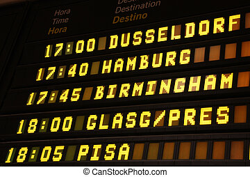 Departure board at an airport in Spain. Flights to...