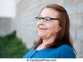 Elderly woman smiling outdoors