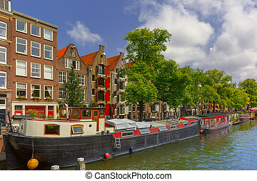 Amsterdam canal with houseboats, Holland - City view of...