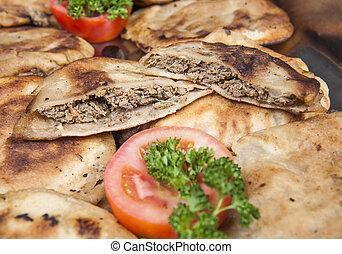 Hawawshi at an oriental restaurant buffet - Arrangement of...