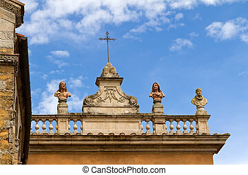 statues on the balcony