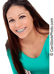 Smiling cool girl with brackets isolated on a white...