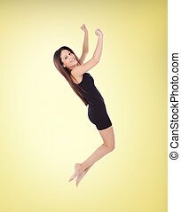 Happy young girl jumping with a short dress