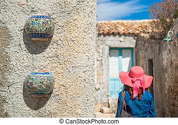 Mediterranean architecture - Colored ceramic jars set as...