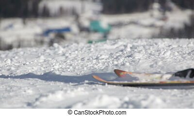 Snowboarders and skiers ride