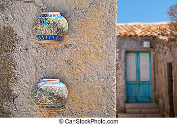 Mediterranean architecture - Colored ceramic jars set as...