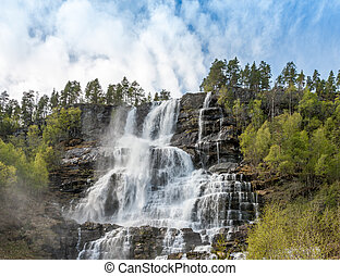waterfall in Norway. mountain landscape in early spring