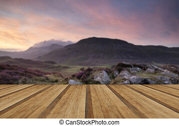 Stunning Summer dawn over mountain range with lake and...