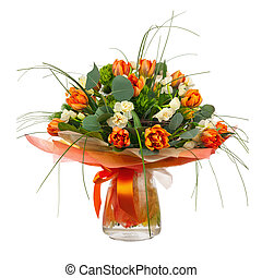 Bouquet of narcissus, tulips and other flowers in glass...