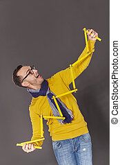 Man showing house frame concept - Excited man holding yellow...