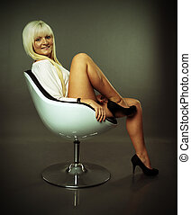 Woman - blonde woman sitting on a chair