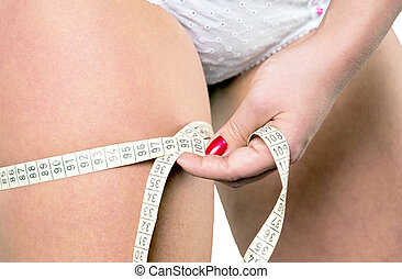 thigh circumference - Woman measuring her thigh...