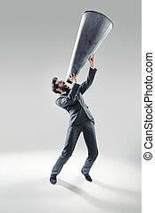 Elegant man yelling over the huge megaphone - Elegant...