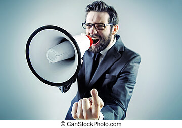 Agressive businessman yelling over the megaphone - Agressive...