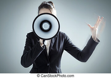 Young businesswoman yelling over megaphone - Young pretty...