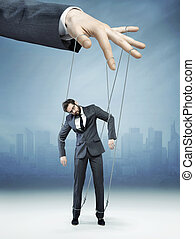 Conceptual picture of controlled employee - Conceptual photo...