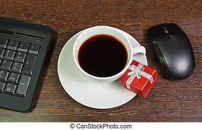 Composition with the cup of coffee, red gift box, mouse and...