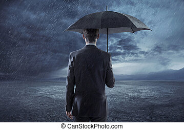Depressed manager standing with an umbrella - Depressed...