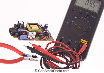 digital multimeter and electronics components - the digital...